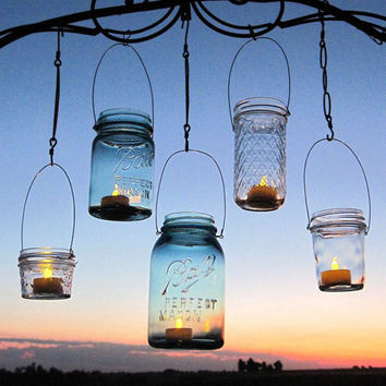Hanging lanterns 20 diy mason jar hangers from treasureagain for Hanging candles diy