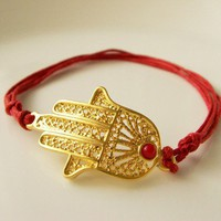 Gold plated brass hamza with red jade bracelet