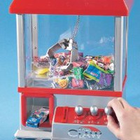 """Amazon.com: """"The Claw"""" Electronic Candy Grabber Machine Arcade Game: Toys & Games"""