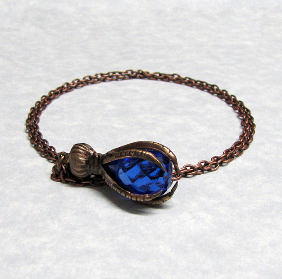 $45.99 Blue Faceted Briolette Steampunk Raven Claw Pendant by ranaway