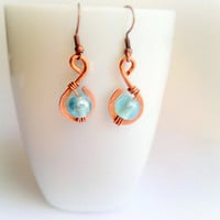 copper wrought earrings blue glass beads by theflowerdesign