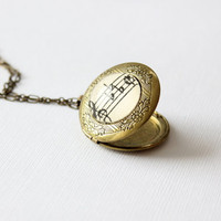 Music locket.  Vintage style brass locket with sheet music under glass.  Victorian keepsake necklace