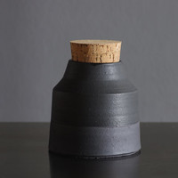 matte black bottle. matte glazed black stoneware bottle with cork stopper. pottery ceramic modern minimal simple