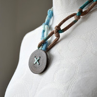 Knitted knotted jewelry necklace with natural wooden button ombre brown blue turquoise colour