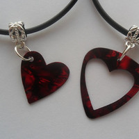 "Red guitar pick heart his and her necklace set that are adjustable from 18"" to 20"""