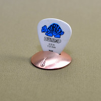 Disc guitar pick stand rocking out in copper