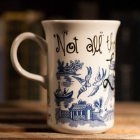 "J.R.R. Tolkien ""Not all those who wander are lost."" - LOTR Literary Quote Mug - Smallish, narrow white mug with oriental blue artwork"