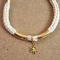 Lucky charm bracelet, four leaf clover charm, knit bracelet with gold bars, cotton cord