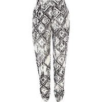 Black and white tribal print trousers
