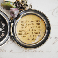 Motherhood Locket - Mother Locket - While we try to teach our children all about life, our children teach us what life is about