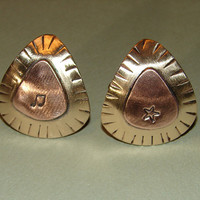 Guitar pick cuff links rocking out in copper on bronze