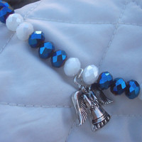 Bracelet of sapphire and white rondelles, with angel pendant