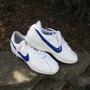 vintage leather NIKE blue swoosh tennis shoe. womens size 10. mens size 8.