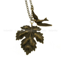 Antique bronze leaf necklace with swallow by luckyvicky on Etsy