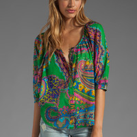 Trina Turk Lingo Blouse in Scene Green from REVOLVEclothing.com