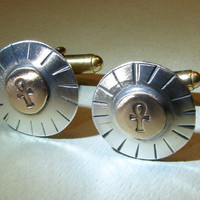 Cuff links from sterling silver and bronze with sun and ankhs