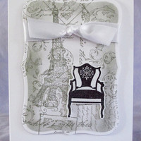 White, gray and black stamped greeting card, Eiffel tower, chair