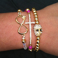 Naughty and Nice Gold Stack Set of 3 Arm Candy Bracelets Skull Infinity and Cross
