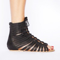 Slashed gladiator sandals