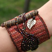Bound to the Past fiber art bracelet by HannaRiverArt on Etsy