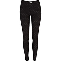 Black polka dot skinny trousers