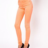 ASOS Ridley Supersoft High Waisted Ultra Skinny Jeans in Neon Orange at asos.com