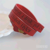 Put on some lipstick engraved leather wrap cuff by BookFiend