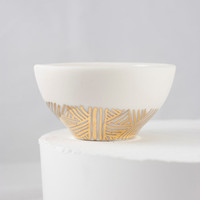 Tiny porcelain bowl with gold pattern