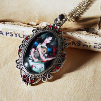 Madness returns Alice in Wonderland - cabochon covered pendant