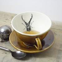 Porcelain Dark Amber Stag Beetle Tea Cup and Saucer