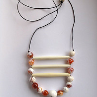 Tribal beaded necklace with faceted amber colored agates bone beads on black leather cord geometric Fall fashion