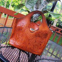distressed hand tooled southwestern tote. leather mexican inspired bag. cut out handles