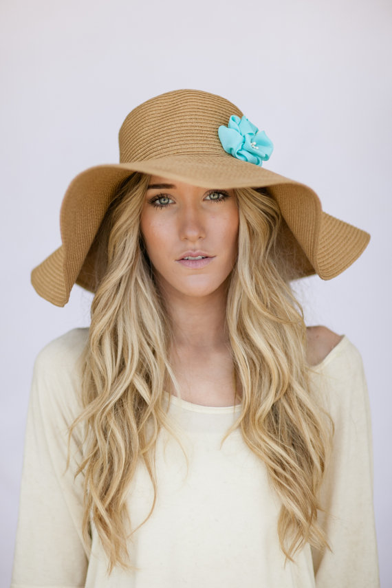 # Ladies Large Floppy Brim Sun Hat Red. Our hats feature attractive antiqued finishes with deep & vibrant colors. Stiffened for durability & to maintain shape.