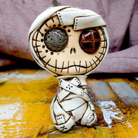 Baby mummy sculpture with vintage buttons in his eyes. Cute and creepy. Ideal for Halloween decoration
