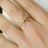 Gold bow ring from Leea