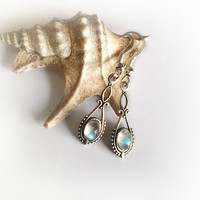 Vintage style ornate earrings with labradorite or moonstone cabochons