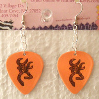 Orange pick with camo deer symbol guitar pick by Featherpick