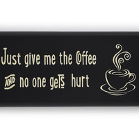 Just give me the coffee and no one gets hurt painted sign.