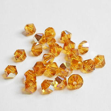 Swarovski 5328 Xillion Crystal Beads Topaz AB 4mm