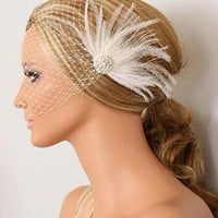 Frija White Peacock Headpiece and Birdcage Veil by portobello