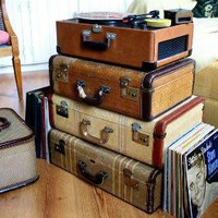 even more luggage! great way to elevate a record player.
