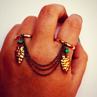 arrowhead and turquoise double ring in gold