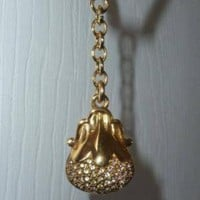 Miniature judith Leiber keyfob of her first purse she ever made and that was the crystal pear!