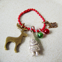 Moose and elf christmas charm, brass moose and silver elf charm with green and red bell and a 2013 charm on a red ball chain