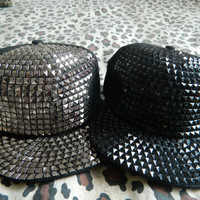 Black and silver studded snapbacks