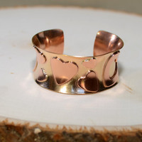 Anticlastic bronze cuff bracelet with copper hearts
