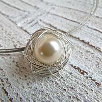 Pendant of silver wire with a crystal pearl