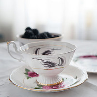 pointing design vintage teacup and saucer by melody rose | notonthehighstreet.com