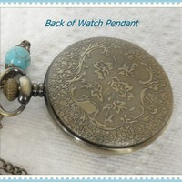 A Beautiful ,Altered in Color Timepiece Watch Pendant Necklace