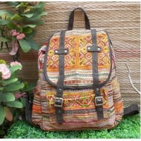backpack from embroidered fabric and leather strap